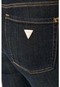 Niebieskie jeansy Guess Jeans z podwyższonym stanem, w kolorowe wzory
