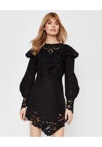 ISABEL MARANT - Czarna sukienka z haftem Ellery. Typ kołnierza: dekolt w kształcie V. Kolor: czarny. Materiał: koronka. Wzór: haft. Długość: mini