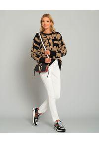 MONCLER - Wełniany sweter z logo. Kolor: czarny. Materiał: wełna. Długość rękawa: długi rękaw. Długość: długie. Sezon: jesień, zima. Styl: klasyczny