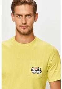 Żółty t-shirt Converse casualowy, z okrągłym kołnierzem, z nadrukiem