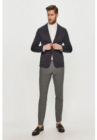 Hugo - Spodnie. Kolor: szary