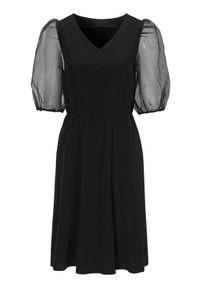 Cellbes Sukienka z organzy z bufiastymi rękawami Czarny female czarny 46/48. Typ kołnierza: dekolt w serek. Kolor: czarny. Materiał: tkanina. Typ sukienki: rozkloszowane. Styl: elegancki