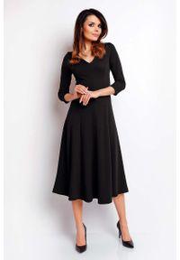 Czarna sukienka rozkloszowana Nommo elegancka