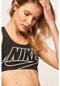 Czarny biustonosz sportowy Nike Dri-Fit (Nike), z nadrukiem