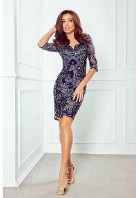 Niebieska sukienka Imesia w koronkowe wzory
