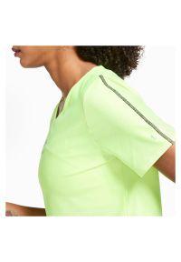 Koszulka damska do biegania Nike Air CU3058. Materiał: tkanina, skóra, poliester, materiał. Długość rękawa: krótki rękaw. Technologia: Dri-Fit (Nike). Długość: krótkie. Wzór: nadruk. Sport: bieganie