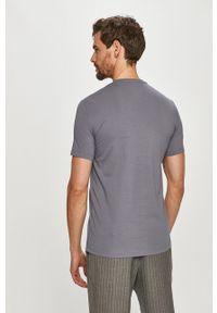 Szary t-shirt Armani Exchange na co dzień, casualowy, z nadrukiem