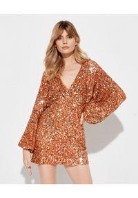 RETROFETE - Pomarańczowa sukienka Aubrielle. Kolor: pomarańczowy. Materiał: materiał. Wzór: aplikacja. Długość: mini
