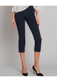 SEDUCTIVE - Eleganckie spodnie wyszczuplające. Okazja: na spotkanie biznesowe, na imprezę. Kolor: niebieski. Materiał: materiał. Wzór: gładki. Sezon: lato. Styl: elegancki