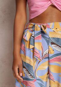 Renee - Niebieskie Spodnie Szerokie Chryaza. Stan: podwyższony. Kolor: niebieski. Materiał: materiał