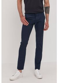 TOMMY HILFIGER - Tommy Hilfiger - Spodnie. Kolor: niebieski. Materiał: tkanina