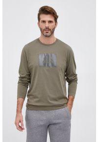 C.P. Company - Longsleeve bawełniany. Okazja: na co dzień. Kolor: zielony. Materiał: bawełna. Długość rękawa: długi rękaw. Wzór: nadruk. Styl: casual