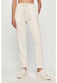 Kremowe spodnie dresowe Jacqueline de Yong melanż
