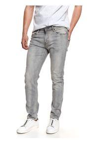 TOP SECRET - Spodnie z jasnego denimu. Kolor: szary. Materiał: denim. Długość: długie. Sezon: lato. Styl: klasyczny