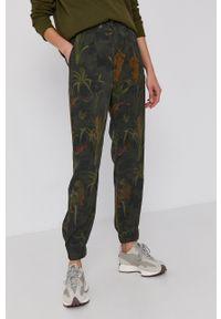 Desigual - Spodnie. Kolor: zielony. Materiał: włókno, tkanina, materiał
