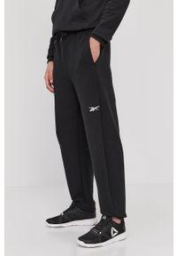 Reebok - Spodnie. Kolor: czarny. Materiał: dzianina, bawełna, poliester, elastan. Wzór: gładki #3