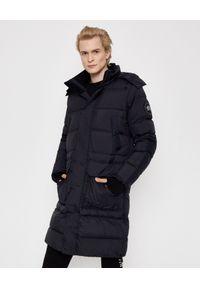 CANADA GOOSE - Czarny płaszcz puchowy Warwick. Kolor: czarny. Materiał: puch. Wzór: paski, aplikacja. Styl: elegancki