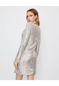 Manila Grace - MANILA GRACE - Cekinowa sukienka z wiązaniem. Typ kołnierza: dekolt sznurowany, dekolt w kształcie V. Kolor: srebrny. Materiał: materiał. Wzór: aplikacja. Styl: elegancki. Długość: mini