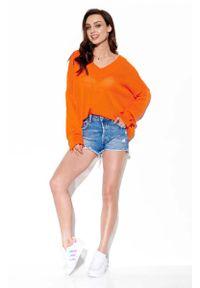 Pomarańczowy sweter oversize Lemoniade