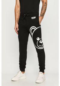 Czarne spodnie dresowe Moschino Underwear z nadrukiem