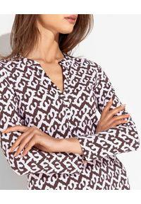 MALIPARMI - Sukienka we wzory. Kolor: brązowy. Materiał: materiał. Wzór: kolorowy. Sezon: wiosna, lato. Długość: maxi