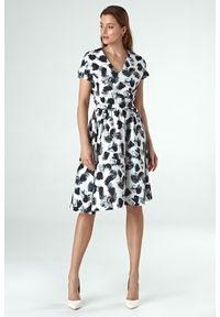 e-margeritka - Sukienka wizytowa rozkloszowana we wzory - 44. Okazja: do pracy, na imprezę. Materiał: materiał, poliester. Typ sukienki: rozkloszowane. Styl: wizytowy. Długość: midi