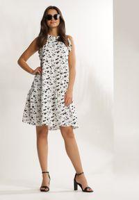Renee - Biała Sukienka Nauticiane. Typ kołnierza: dekolt halter. Kolor: biały. Wzór: kwiaty, aplikacja. Długość: mini