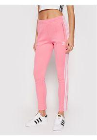 Adidas - adidas Spodnie dresowe Primeblue SST Track H34581 Różowy Slim Fit. Kolor: różowy. Materiał: dresówka