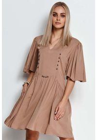 Makadamia - Rozkloszowana Sukienka z Metalowymi Dżetami - Cappuccino. Materiał: wiskoza