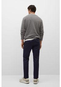 Mango Man - Spodnie Prato. Kolor: niebieski