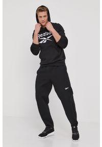 Reebok - Spodnie. Kolor: czarny. Materiał: dzianina, bawełna, poliester, elastan. Wzór: gładki #4