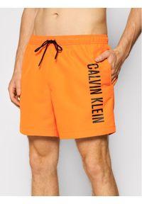 Calvin Klein Swimwear Szorty kąpielowe Medium Drawstring KM0KM00570 Pomarańczowy Regular Fit. Kolor: pomarańczowy