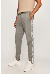 Szare spodnie dresowe Calvin Klein Jeans z aplikacjami