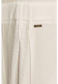 Biały kombinezon Armani Exchange krótki, casualowy, na co dzień, z krótkim rękawem