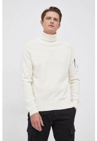 C.P. Company - Sweter wełniany. Okazja: na co dzień. Typ kołnierza: golf. Kolor: beżowy. Materiał: wełna. Długość rękawa: długi rękaw. Długość: długie. Styl: casual
