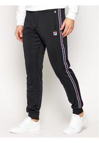 Fila Spodnie dresowe Salih 687849 Czarny Regular Fit. Kolor: czarny. Materiał: dresówka