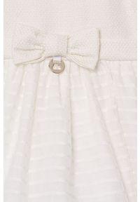 Kremowa sukienka Mayoral z krótkim rękawem, rozkloszowana, mini