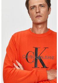 Pomarańczowa bluza nierozpinana Calvin Klein Jeans bez kaptura, casualowa