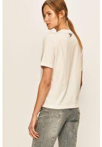 Biała bluzka Reebok Classic z nadrukiem, na co dzień