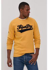 Superdry - Bluza. Kolor: żółty. Materiał: dzianina. Wzór: aplikacja