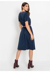 Sukienka kopertowa, krótki rękaw bonprix ciemnoniebiesko-biało-czerwony. Typ kołnierza: dekolt w serek. Kolor: niebieski. Długość rękawa: krótki rękaw. Wzór: kolorowy, paski. Typ sukienki: kopertowe. Styl: elegancki