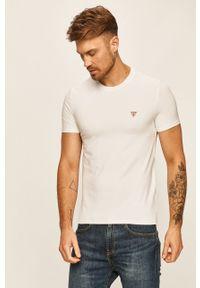 Biały t-shirt Guess Jeans casualowy, z okrągłym kołnierzem