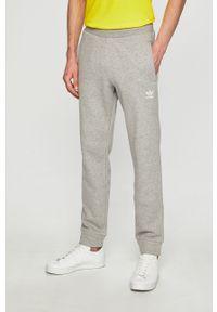 Szare spodnie dresowe adidas Originals melanż