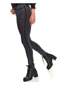TOP SECRET - Spodnie damskie z ozdobnymi taśmami. Okazja: na co dzień. Stan: podwyższony. Kolor: niebieski. Materiał: jeans. Długość: długie. Sezon: jesień. Styl: casual