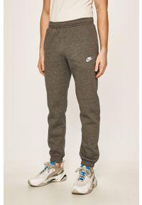 Nike Sportswear - Spodnie. Kolor: szary