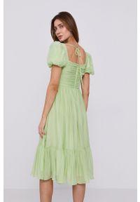 Miss Sixty - Sukienka. Kolor: zielony. Materiał: tkanina. Długość rękawa: krótki rękaw. Wzór: gładki. Typ sukienki: rozkloszowane