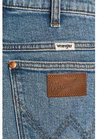 Wrangler - Jeansy Wild West 603. Kolor: niebieski