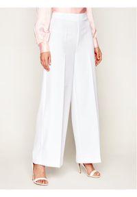 Białe spodnie Guess