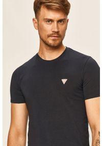 Niebieski t-shirt Guess Jeans z aplikacjami, casualowy
