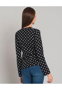 COMME DES GARCONS PLAY - Czarna bluzka w kropki z sercem. Kolor: czarny. Materiał: bawełna, jeans. Długość rękawa: długi rękaw. Długość: długie. Wzór: kropki. Styl: klasyczny